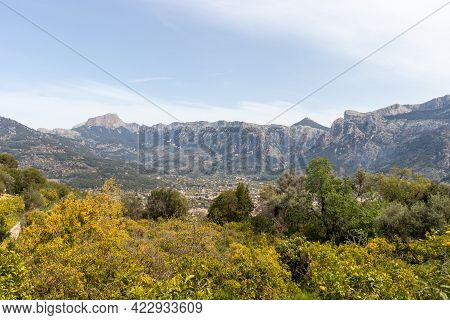 Panoramic View City Soller With Lush Vegetation And Mountain Scenery