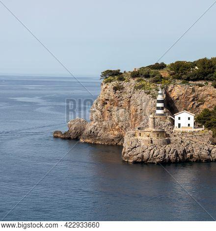 Lighthouse Mallorca At Tip Of Port De Soller