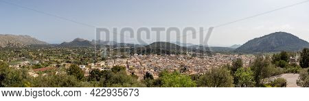 Panorama City Town Of Pollenca Or Pollensa In Mallorca With Mountain Scenery Background