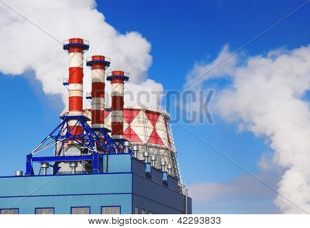 Smoking pipes of gas-turbine plant against blue sky poster