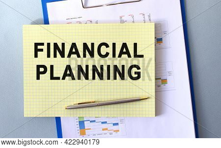 Financial Planning Text Written On Notepad With Pencil. Notepad On A Folder With Diagrams. Financial