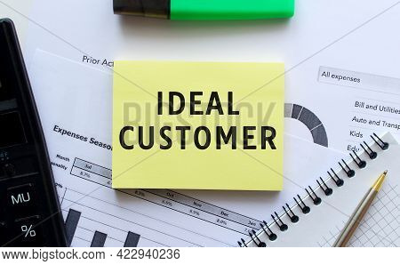 Text Ideal Customer On The Page Of A Notepad Lying On Financial Charts On The Office Desk. Near The