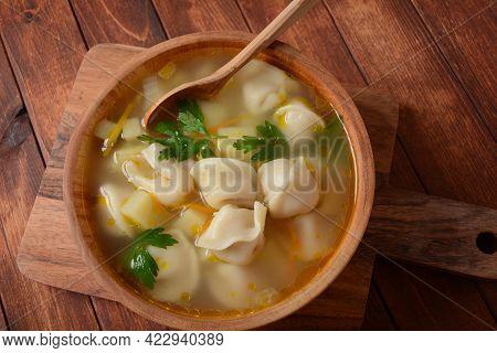 Soup With Pelmeni (russian Dumplings). Soup With Meat Dumplings, Potatoes And Other Vegetables