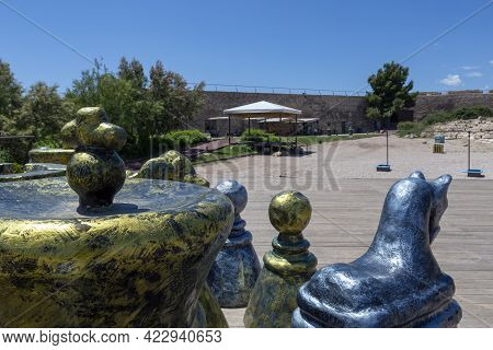 Closeup Of Large Outdoor Giant Chess Pieces Located In The Parade Ground Of The Medieval Castle Of L