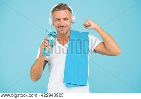 Sportsman Promote Healthy Lifestyle. Happy Sportsman On Blue Background. Fit Sportsman With Towel. H