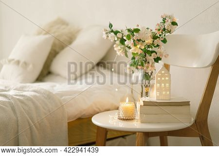 Book, Candle And Vase With Apple Spring Flowers.