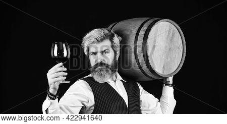 Sommelier At Work. Bearded Businessman In Elegant Suit With Barrel. Sommelier Tastes Expensive Drink