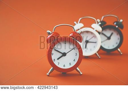 Outstanding Red Analog Alarm Clock With Blurred Black And White On Grunge Orange Background, Leading