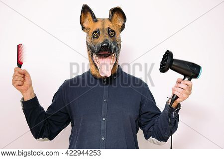 Person With A Dog Mask Holding A Hairbrush And A Hairdryer On White Background, Concept Of Canine Ha
