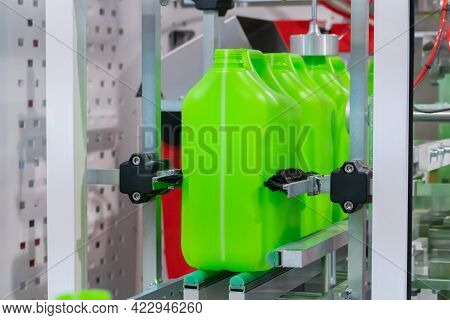 Empty Green Plastic Jerrycans Moving On Conveyor Belt Of Automatic Pet Blow Molding Machine At Facto