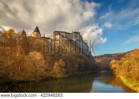 The Medieval Orava Castle Above A River At Autumn, Slovakia, Europe.
