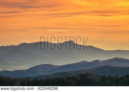 Mountains Colored In Shades Of Orange At Sunset In Autumn. The Klak In The Mala Fatra Mountain Range