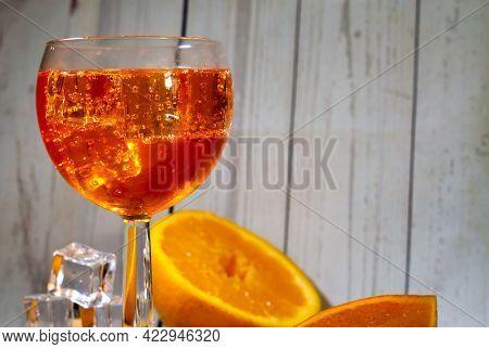 Horizontal Italian Spritz With Ice Cubes And Oranges