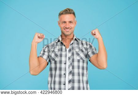 Casual And Powerful. Strong Guy Flex Arms Blue Background. Handsome Man In Casual Style. Casual Fash