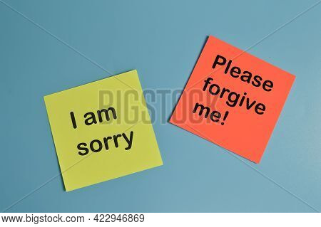 Paper Notes Written With I Am Sorry And Please Forgive Me!