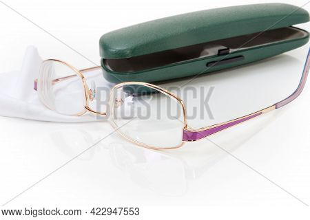 Modern Classic Eyeglasses For Women In Metal Yellow Rim Against The Hard Spectacle-case And Glasses