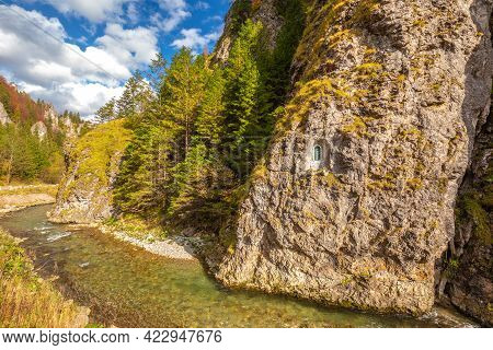 River Through A Rocky Gorge In A Mountain Valley At Autumn. The Vratna Valley In Mala Fatra National