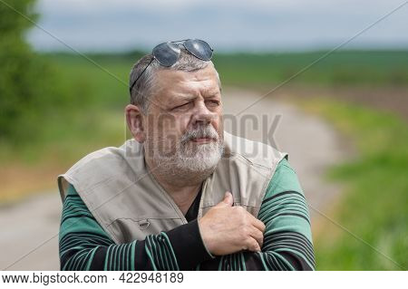 Nice Outdoor Portrait Of Bearded Caucasian Senior Man Wearing  Black Sunglasses On Top Of The Head A