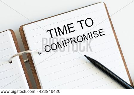 Notepad With Text Time To Negotiate On White Table. Business Concept