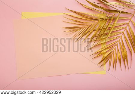 Pink Card Copy Space For Text In Frame Made Of Golden Palm Leaf. Tropical Palm Leave On Pink Backgro