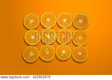 Top View Summer Pattern Of Fresh Orange Slices Isolated On Orange Color Gradient Background With Cli
