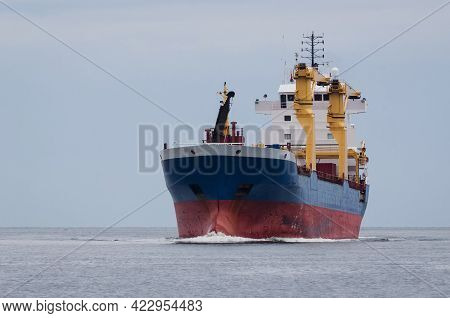 Merchant Vessel - Freighter Sails On The Sea