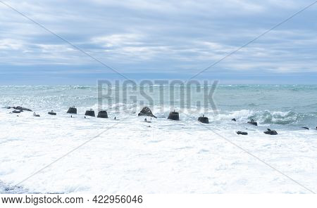 Waves Breaking On Marine Concrete Breakwaters In Shallow Water. Traveling-wave Protection, Concrete
