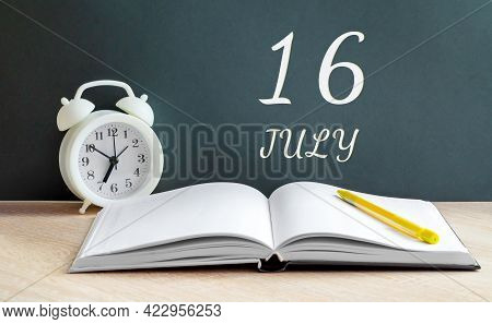 July 16. 16-th Day Of The Month, Calendar Date.a White Alarm Clock, An Open Notebook With Blank Page