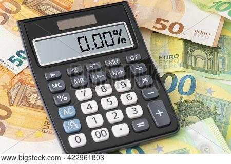 Calculator Showing Zero Percent Interest Rate On Euro Banknotes, Cheap Borrowing Concept