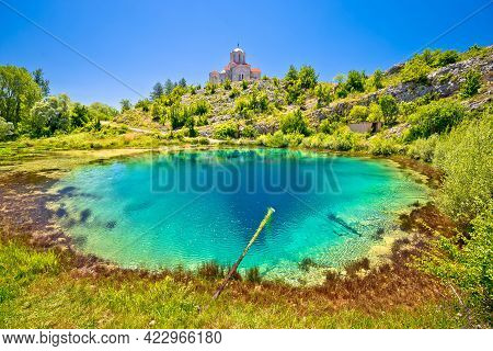 Cetina River Source Water Hole And Orthodox Church On The Hill View, Dalmatian Zagora Region Of Croa