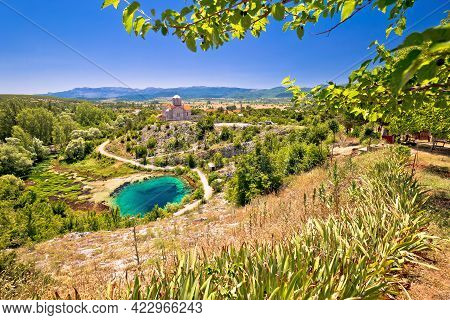 Cetina River Source Water Hole And Orthodox Church View, Dalmatian Zagora Region Of Croatia