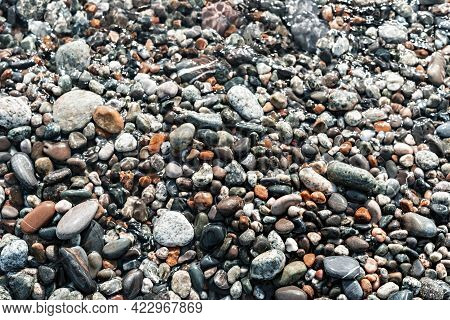 Pebble Shore Close Up, Natural Background Copy Space, Gray And Red Pebbles In Sea Water, Stones, Tex
