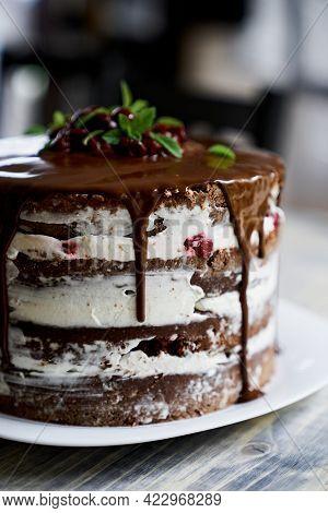 Chocolate Brownie Cake On A Plate. Close-up