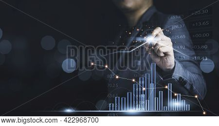 Businessman Drawing Virtual Technical Graph And Chart For Analysis Stock Market, Technology Investme