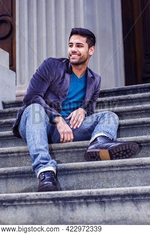 Young Man Relaxing Outside. Dressing In A Dark Purple Woolen Blazer, Blue Jeans, And Black Leather S