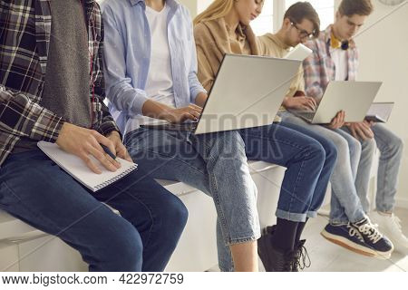 Diverse High School Teenager Student Group Studying Using Laptop Cropped Shot