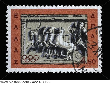 ZAGREB, CROATIA - JUNE 25, 2014: Stamp printed in Greece from the Olympic Games issue shows Chariot racing, marble votive relief, circa 1964.