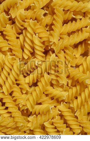 Close Up Of Dry Uncooked Yellow Fusilli