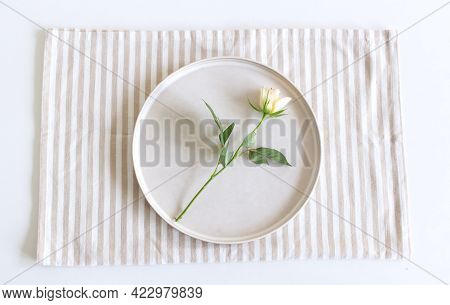 Festive Table Setting. Empty Plate, Napkin And White Rose On White Table. Top View, Flat Lay, Copy S