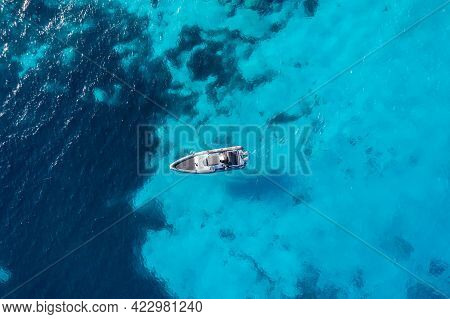 Greece, Cyclades. Aerial Drone View Of A Speed Boat On Turquoise Color Sea Water