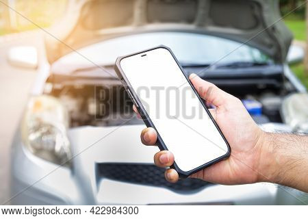 Male Hand Holding A Black Smartphone With A White Touch Screen Call An Insurance Company Or A Mechan