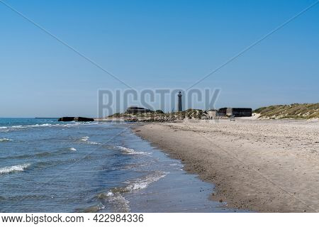 Landscape View Of Old Bunkers On The Beaches At Skagen In North Denmark With The Lighthouse In The B