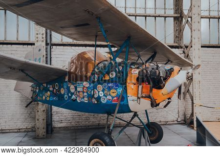 Brussels, Belgium - August 17, 2019: Antique Aircraft With Stickers Over The Fuselage Inside Aviatio