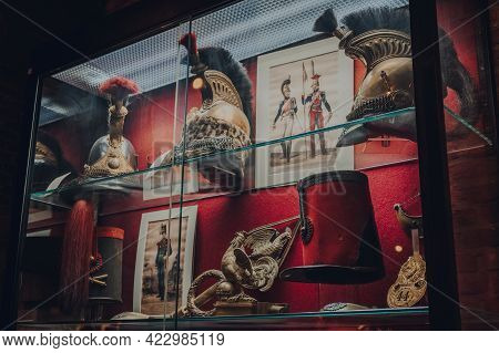Brussels, Belgium - August 17, 2019:  Variety Of Military Helmets On Exhibit In The Royal Museum Of