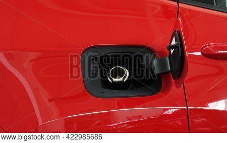 Open fuel tank door on car for fueling gasoline or diesel open. Transportation industry concept