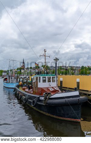 Flensburg, Germany - 27 May, 2021: Close Up View Of An Old Tugboat In The Harbor At Flensburg