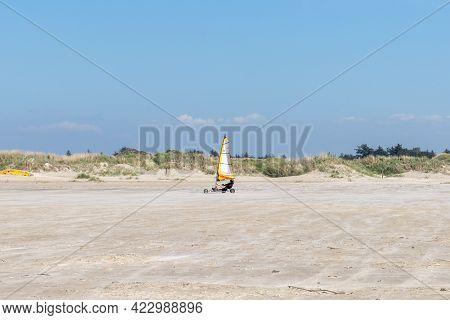 Blokart Wind Buggy Enjoying A Windy Day On The Wadden Sea Island Beaches Of Western Denmark