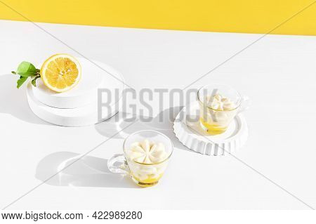 Lemon Mousse Or Ice Cream In A Glass Cups On Yellow Background. Traditional Italian Recipe Of Lemon