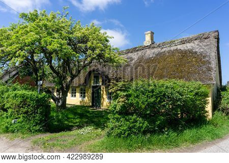 Sonderho, Denmark - 29 May, 2021: Traditional Danish House With Thatched Reed Roof In A Coastal Sand