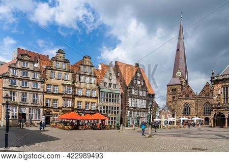 Colorful Old Guild Houses On The Market Square In The Historic Old City Center Of Bremen With The Ch